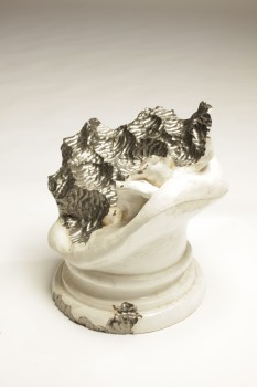 Sculpture eaten by snail b